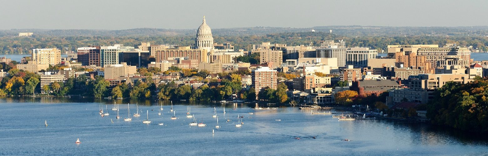 Isthmus of Madison, highlighting the UW campus. The Wisconsin capitol is visible as well as Lake Mendota to the front and Lake Monona to the back